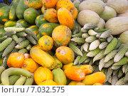 Купить «Фон из тропических фруктов и овощей», фото № 7032575, снято 12 февраля 2013 г. (c) Сергей Дубров / Фотобанк Лори