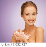 Купить «beautiful smiling woman holding flower petals», фото № 7032727, снято 16 сентября 2012 г. (c) Syda Productions / Фотобанк Лори