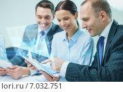 Купить «business team with tablet pc having discussion», фото № 7032751, снято 9 ноября 2013 г. (c) Syda Productions / Фотобанк Лори
