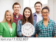 Купить «group of students at school with clock», фото № 7032807, снято 16 июня 2013 г. (c) Syda Productions / Фотобанк Лори