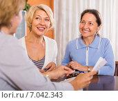 Купить «Female pensioners with public notary», фото № 7042343, снято 23 октября 2018 г. (c) Яков Филимонов / Фотобанк Лори