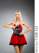 Woman with movie board wearing red dress. Стоковое фото, фотограф Elnur / Фотобанк Лори