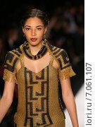 Купить «NEW YORK, NY - FEBRUARY 19: A model walks the runway in a Li Jon Sculptured Couture design at the Art Hearts Fashion show during MBFW Fall 2015 at Lincoln Center on February 19, 2015 in NYC», фото № 7061107, снято 19 февраля 2015 г. (c) Anton Oparin / Фотобанк Лори