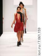 Купить «NEW YORK, NY - FEBRUARY 19: Models walk the runway in a Li Jon Sculptured Couture design at the Art Hearts Fashion show during MBFW Fall 2015 at Lincoln Center on February 19, 2015 in NYC», фото № 7061159, снято 19 февраля 2015 г. (c) Anton Oparin / Фотобанк Лори