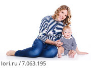 Купить «Portrait of a happy mother with a small child in her arms.», фото № 7063195, снято 13 ноября 2019 г. (c) Александр Савченко / Фотобанк Лори