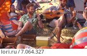 Купить «In high quality format pretty hipster relaxing on campsite », видеоролик № 7064327, снято 17 февраля 2019 г. (c) Wavebreak Media / Фотобанк Лори