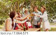 Купить «In slow motion group of friends celebrating oktoberfest», видеоролик № 7064571, снято 8 июля 2020 г. (c) Wavebreak Media / Фотобанк Лори