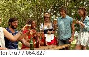 Купить «In high quality format group of friends celebrating oktoberfest », видеоролик № 7064827, снято 17 февраля 2019 г. (c) Wavebreak Media / Фотобанк Лори