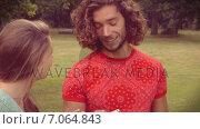Купить «In high quality format happy friends in the park using their phones », видеоролик № 7064843, снято 22 августа 2018 г. (c) Wavebreak Media / Фотобанк Лори