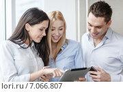 Купить «business team working with tablet pcs in office», фото № 7066807, снято 23 ноября 2013 г. (c) Syda Productions / Фотобанк Лори