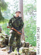 Купить «young soldier or hunter with gun in forest», фото № 7067343, снято 14 августа 2014 г. (c) Syda Productions / Фотобанк Лори