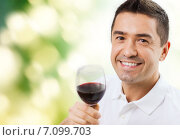 Купить «happy man drinking red wine from glass», фото № 7099703, снято 29 января 2015 г. (c) Syda Productions / Фотобанк Лори