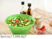 Купить «close up of salad bowl and spices on kitchen table», фото № 7099827, снято 30 апреля 2014 г. (c) Syda Productions / Фотобанк Лори