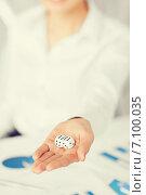 Купить «man hands with gambling dices signing contract», фото № 7100035, снято 24 апреля 2013 г. (c) Syda Productions / Фотобанк Лори