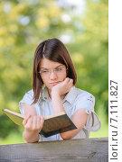 Купить «portrait of beautiful reading brunette girl», фото № 7111827, снято 30 июня 2011 г. (c) BestPhotoStudio / Фотобанк Лори