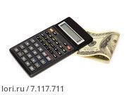 Купить «Бизнес-натюрморт с предметами бизнеса. Доллары и калькулятор», эксклюзивное фото № 7117711, снято 30 января 2015 г. (c) Юрий Морозов / Фотобанк Лори