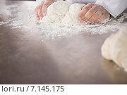 Купить «Close up of baker preparing dough», фото № 7145175, снято 8 сентября 2014 г. (c) Wavebreak Media / Фотобанк Лори