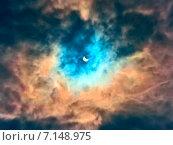 Купить «Солнечное затмение в облаках», фото № 7148975, снято 20 марта 2015 г. (c) Юрий Плющев / Фотобанк Лори