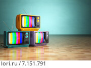 Купить «Vintage television concept. Stack of retro tv set on green background.», фото № 7151791, снято 10 февраля 2020 г. (c) Maksym Yemelyanov / Фотобанк Лори