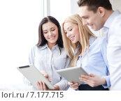 Купить «business team working with tablet pcs in office», фото № 7177715, снято 23 ноября 2013 г. (c) Syda Productions / Фотобанк Лори