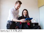 Купить «happy woman and stylist with tablet pc at salon», фото № 7178251, снято 15 февраля 2015 г. (c) Syda Productions / Фотобанк Лори