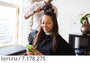 Купить «happy woman with stylist making hairdo at salon», фото № 7178275, снято 15 февраля 2015 г. (c) Syda Productions / Фотобанк Лори