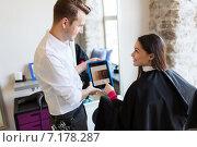 Купить «happy woman and stylist with tablet pc at salon», фото № 7178287, снято 15 февраля 2015 г. (c) Syda Productions / Фотобанк Лори