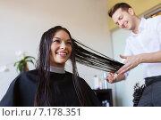 Купить «happy woman with stylist cutting hair at salon», фото № 7178351, снято 15 февраля 2015 г. (c) Syda Productions / Фотобанк Лори