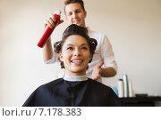 Купить «happy woman with stylist making hairdo at salon», фото № 7178383, снято 15 февраля 2015 г. (c) Syda Productions / Фотобанк Лори