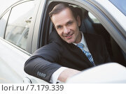 Купить «Handsome businessman smiling at camera», фото № 7179339, снято 10 сентября 2014 г. (c) Wavebreak Media / Фотобанк Лори