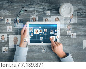 close up of hands with tablet pc and network. Стоковое фото, фотограф Syda Productions / Фотобанк Лори