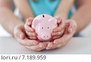 Купить «close up of family hands with piggy bank», фото № 7189959, снято 9 апреля 2014 г. (c) Syda Productions / Фотобанк Лори