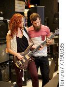 Купить «musicians playing bass guitar at music store», фото № 7190035, снято 11 декабря 2014 г. (c) Syda Productions / Фотобанк Лори