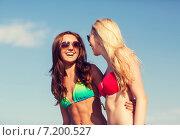 Купить «two laughing young women on beach», фото № 7200527, снято 26 июля 2014 г. (c) Syda Productions / Фотобанк Лори