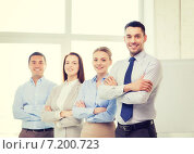 Купить «smiling businessman in office with team on back», фото № 7200723, снято 5 апреля 2014 г. (c) Syda Productions / Фотобанк Лори