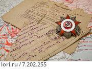 Купить «Орден Отечественной войны и солдатское письмо полевой почты», фото № 7202255, снято 20 января 2019 г. (c) Igor Lijashkov / Фотобанк Лори