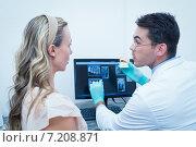 Купить «Dentist showing woman prosthesis teeth», фото № 7208871, снято 16 апреля 2014 г. (c) Wavebreak Media / Фотобанк Лори