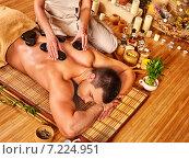 Купить «Man getting stone therapy massage .», фото № 7224951, снято 21 октября 2012 г. (c) Gennadiy Poznyakov / Фотобанк Лори