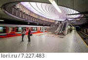 """Купить «Pictured: Plac Wilsona metro station (On 7 April 2008 during the Metrorail convention it won a Metro award for the best recently constructed station). The Warsaw Metro consists of two lines, the north–south Line 1 that links central Warsaw with its densely populated northern and southern suburbs, and the initial segment of the east-west Line 2 that opened on March 8, 2015. In 2009, the Warsaw Metro won two """"Metro Award"""" prizes in the categories of """"Special Merit Award for Commitment to the Environment"""" and """"Best Maintenance Programme"""". These were followed by the Most Improved Metro award in 2011.», фото № 7227483, снято 8 марта 2015 г. (c) BE&W Photo / Фотобанк Лори"""