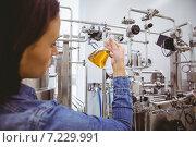 Купить «Stylish girl in denim jacket holding beaker of beer», фото № 7229991, снято 30 июля 2014 г. (c) Wavebreak Media / Фотобанк Лори