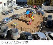 Купить «Детская площадка в окружении автомашин», фото № 7247319, снято 12 апреля 2015 г. (c) Светлана Кириллова / Фотобанк Лори