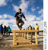 Прыжки через нарты (2015 год). Редакционное фото, фотограф Алексей Маринченко / Фотобанк Лори
