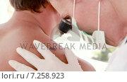 Купить «Doctor examining a spot at her patient », видеоролик № 7258923, снято 25 сентября 2018 г. (c) Wavebreak Media / Фотобанк Лори