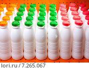 Купить «Молочные продукты в бутылках с цветными крышками», фото № 7265067, снято 8 мая 2012 г. (c) Куликов Константин / Фотобанк Лори