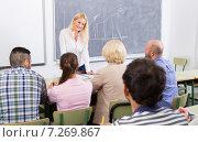 Купить «Adult students with teacher in classroom», фото № 7269867, снято 20 апреля 2018 г. (c) Яков Филимонов / Фотобанк Лори