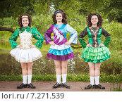 Купить «Три молодые женщины в платье для ирландского танца», фото № 7271539, снято 29 июня 2014 г. (c) Darkbird77 / Фотобанк Лори