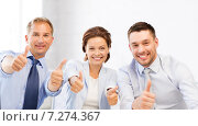 Купить «business team showing thumbs up in office», фото № 7274367, снято 9 июня 2013 г. (c) Syda Productions / Фотобанк Лори