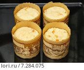 Купить «Сырое тесто для пасхальных куличей в бумажных формах», эксклюзивное фото № 7284075, снято 10 апреля 2015 г. (c) Dmitry29 / Фотобанк Лори