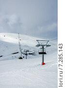 Купить «Сидения горнолыжного подъемника», фото № 7285143, снято 11 апреля 2015 г. (c) Ирина Балина / Фотобанк Лори