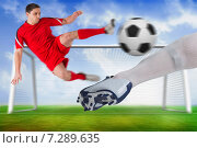 Купить «Composite image of football players tackling for the ball», фото № 7289635, снято 25 июня 2019 г. (c) Wavebreak Media / Фотобанк Лори